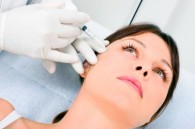 Woman receiving cosmetic injectable